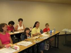 Homeschool moms and students gather information at a local homeschool workshop