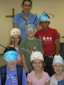 Trilobyte masks on homeschoolers in a science class.