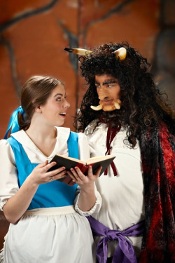 Belle shares her favorite book with Beast in CYT's Beauty and the Beast.