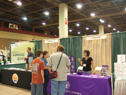 Nicole Porter, Grand Canyon University admissions counselor, speaks with attendees at the 2009 AFHE homeschool convention.